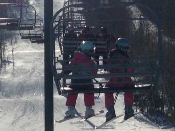 Students going up a ski lift