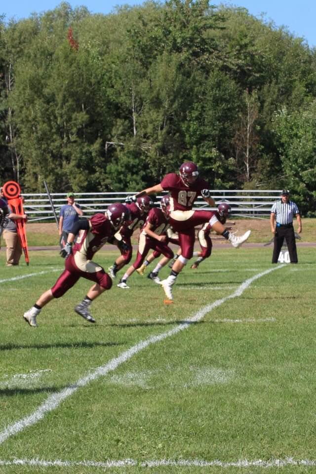 The football team running a play
