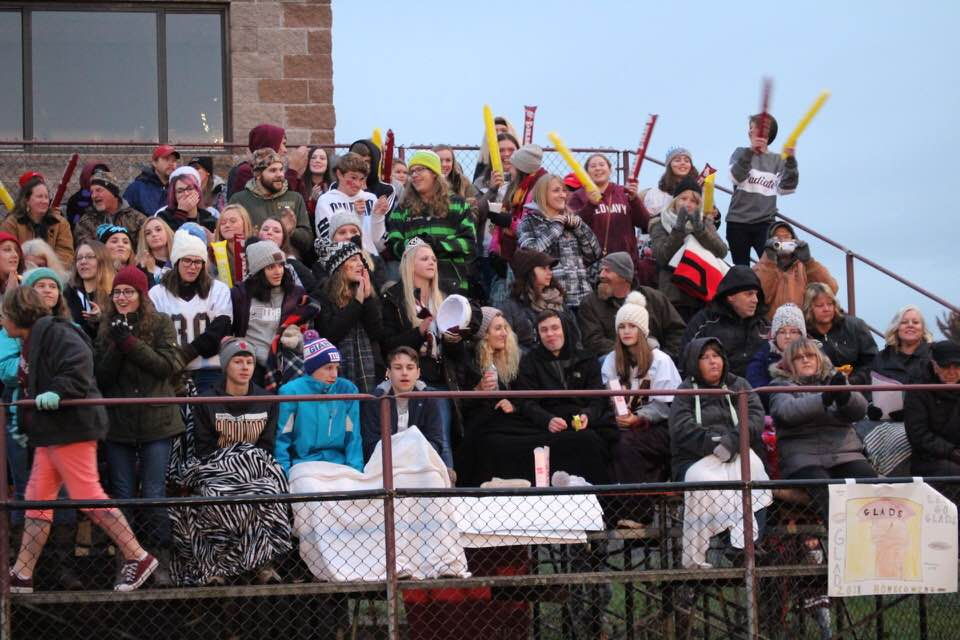 Football fans watching the game while bundled up in the cold